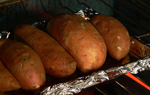 Place the pan of sweet potatoes in the pre-heated oven.