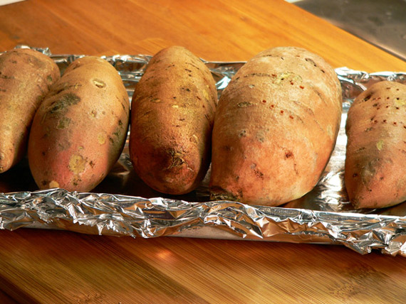 Arrange the sweet potatoes in a foil lined baking pan.