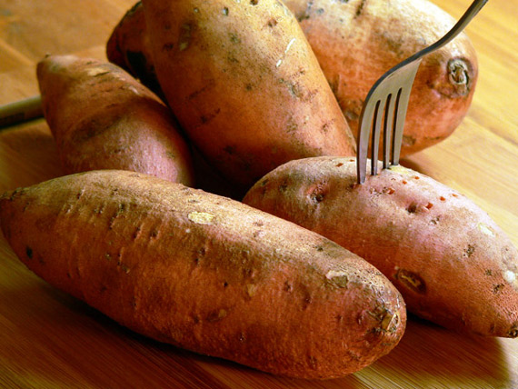 Pierce the sweet potatoes with a fork.