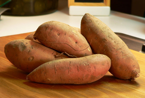 Raw sweet potatoes waiting to be baked.