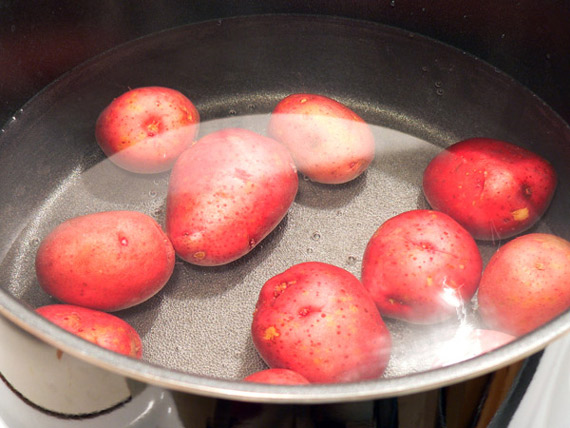 Boil the potatoes in water.