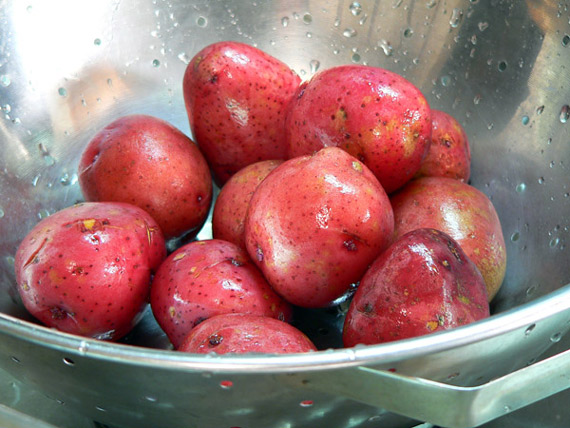 Start by washing your potatoes