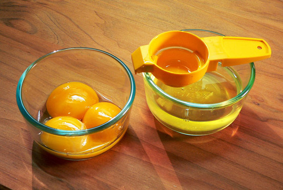 Separate three eggs, placing whites and yolks in seperate small bowls.