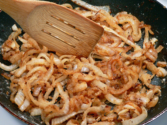 stir the flour into the onions