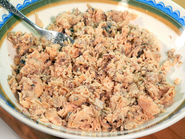 Place salmon in a large mixing bowl.