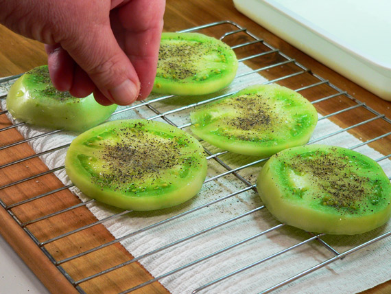 Sprinkle the green tomatoes with a little sugar.