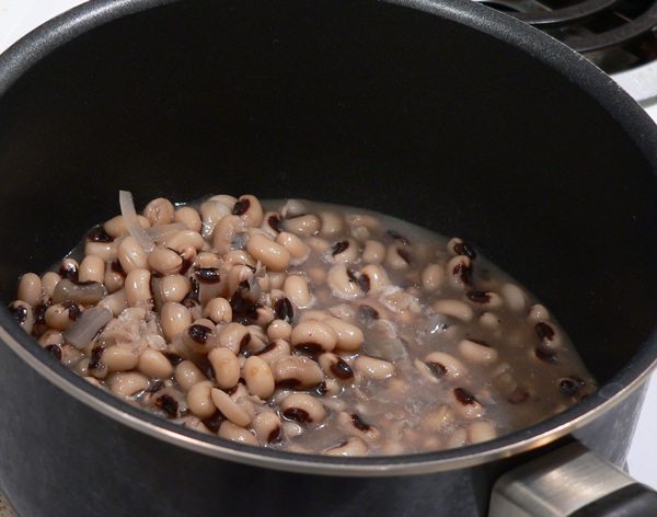 Place the black eye peas in a saucepan.