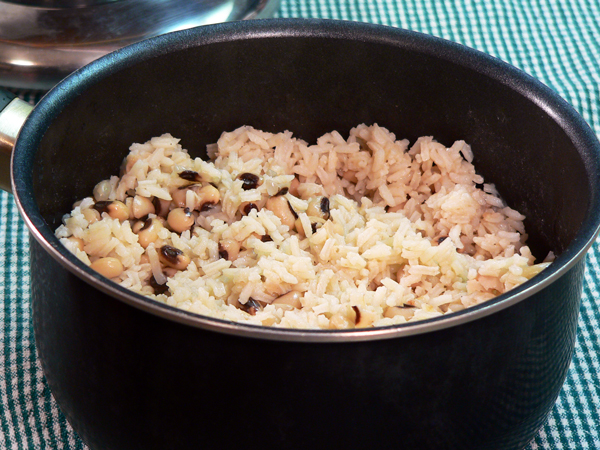 Fluff the rice up while it's still in the pot.