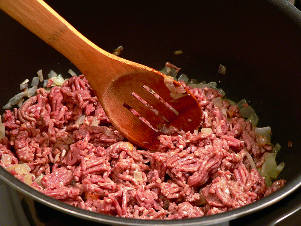 Add the ground beef.