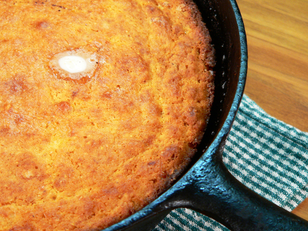 The cornbread has pulled from the sides of the pan.