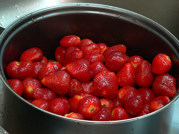 Strawberry Jam, add the berries to the pot.