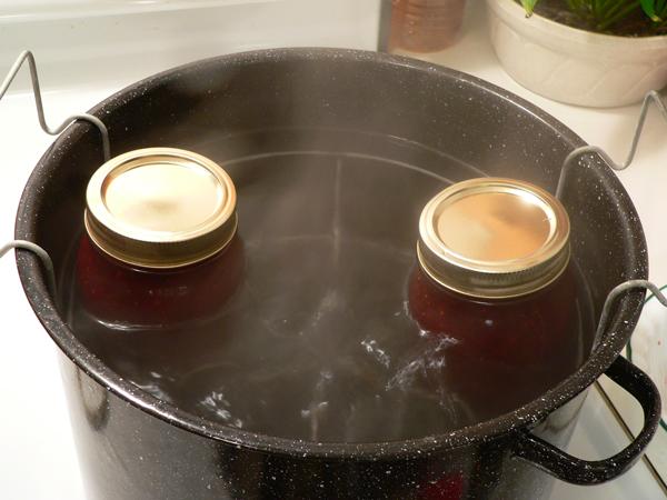 Strawberry Jam, place jars in rack.