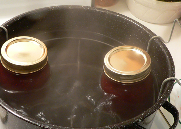 Strawberry Jam, raise the jars and let them sit a few minutes.