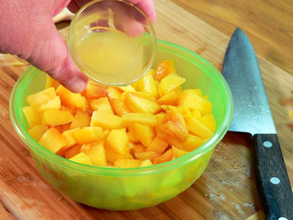 Peach Preserve Ice Cream, add the lemon juice to the cut peaches.