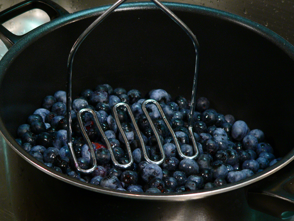 Blueberry Jam, prepare to mash the berries.