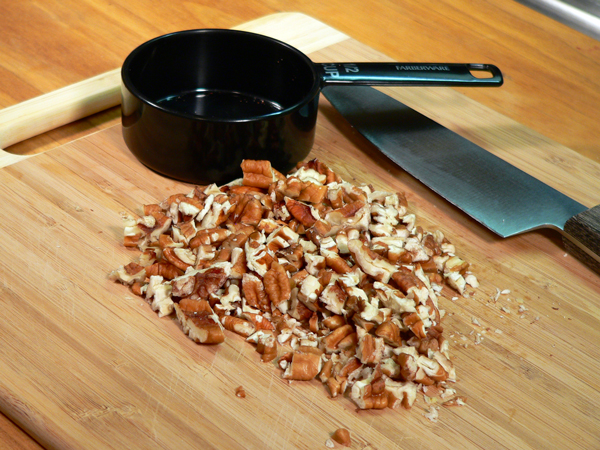 Praline-Apple Bread, chop up the pecans.