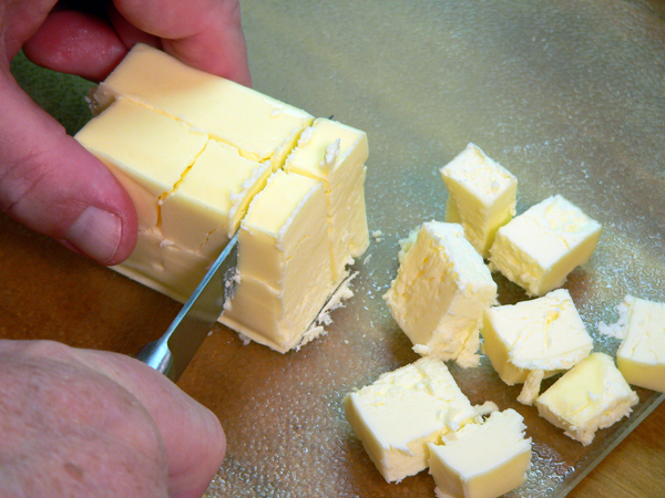 Basic Pie Crust, lay the slices down and slice into cubes.
