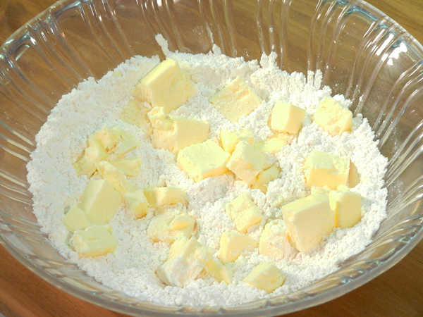 Basic Pie Crust, add the butter to the flour.