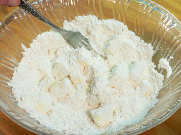 Basic Pie Crust, toss the cubes in the flour.