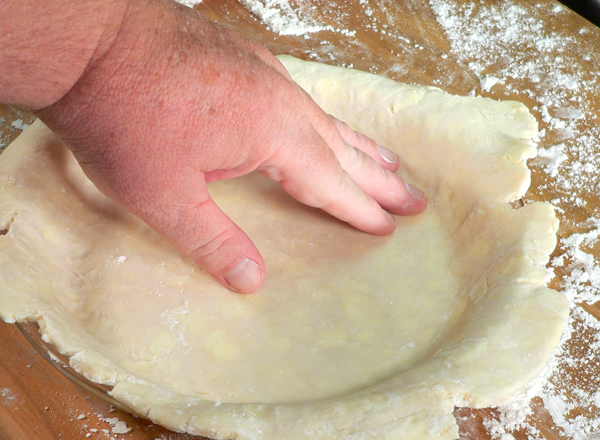 Basic Pie Crust, gently press the edges into the corners.
