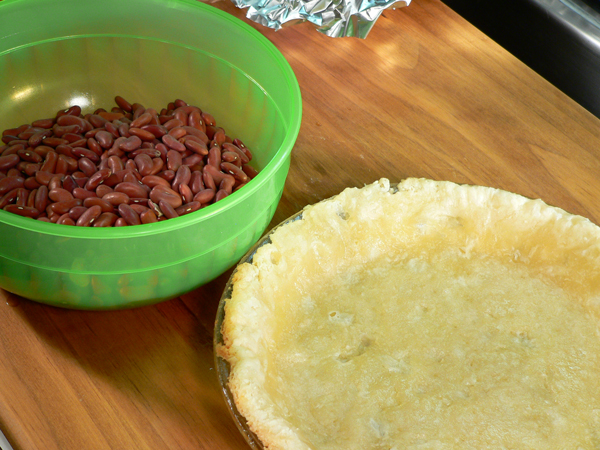 Basic Pie Crust, remove the beans and foil.