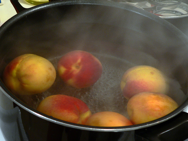 Peach Jam, heat the peaches.