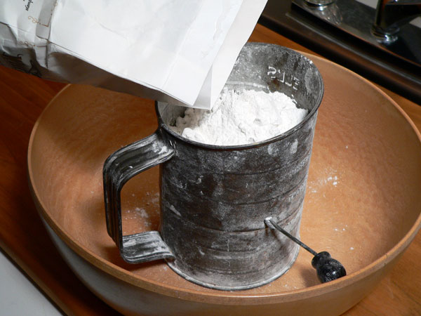 Mini Biscuits Recipe, add flour to the sifter.