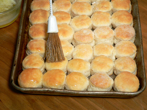 Mini Biscuits, brush the tops with butter.