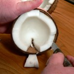 coconut, slip knife under edge.