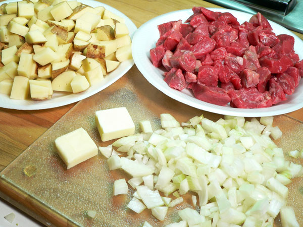 Vegetable Beef Soup, chop the onion.