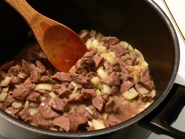 Vegetable Beef Soup, stir the onions.