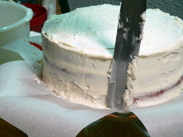 Red Velvet Cake, crumb coat the layers.