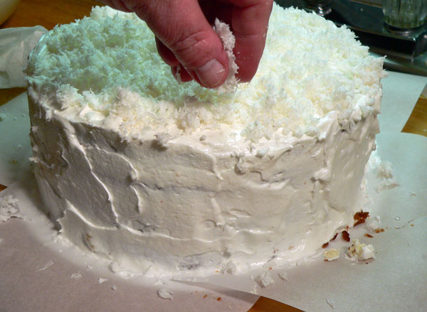 Seven Minute Frosting, adding the coconut.