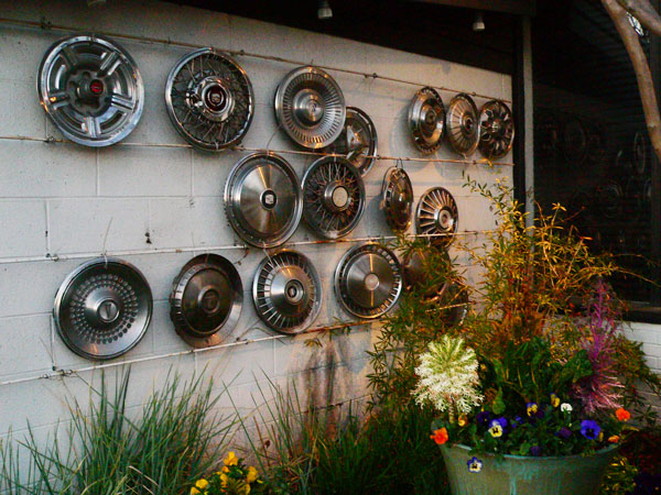 Our State Launch Party, hubcaps on the wall.