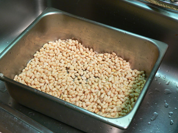 Baked Beans, place beans in baking dish.