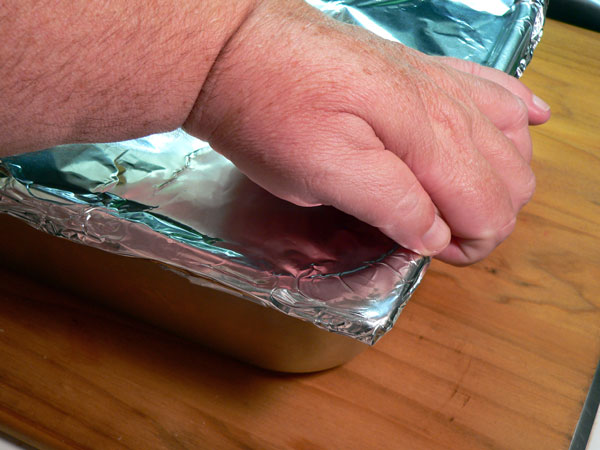Baked Beans, cover tightly with aluminum foil.