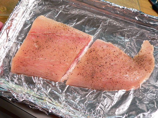 Mahi-Mahi, grease your broiling pan then, add the fillets.