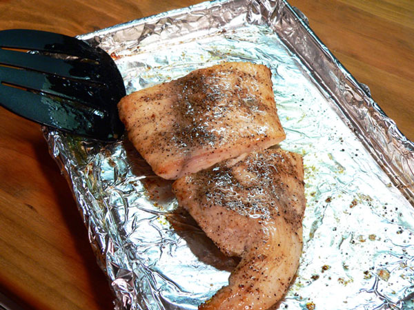 Mahi-Mahi, after 4-5 minutes, flip the fillet over and brush the other side with the butter mixture.
