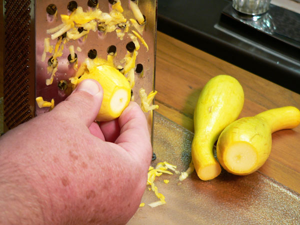 Squash Fritters, grate the squash.