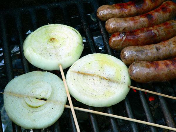 Vidalia Steaks, place onion steaks on the grill.