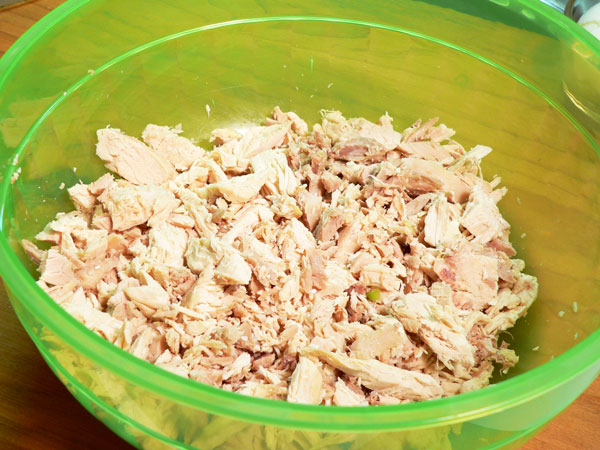 Southern Chicken Salad, place the cutup chicken in a large mixing bowl.
