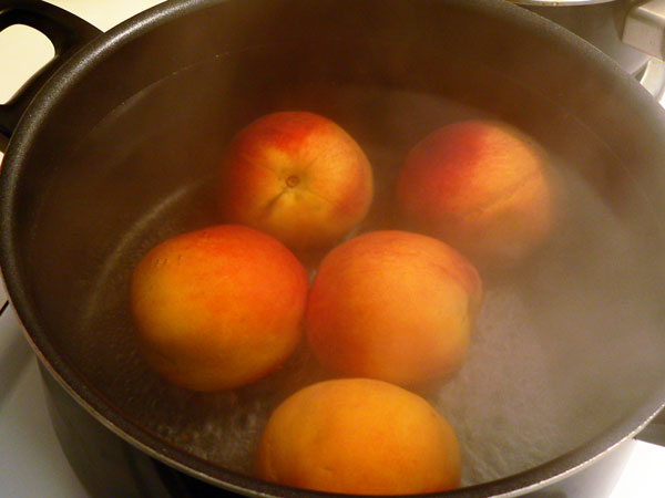 Peach Butter, place in boiling water.
