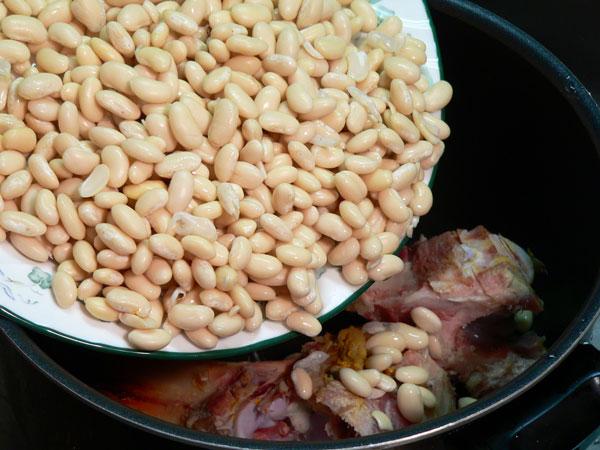 Ham Bone Beans, add the beans.