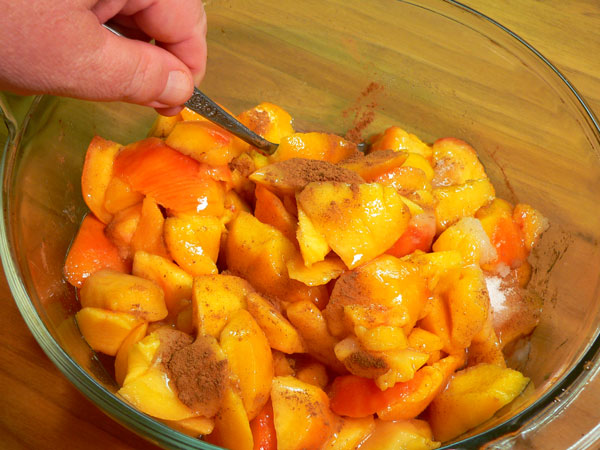 Peach Delight Cobbler, toss gently to mix.
