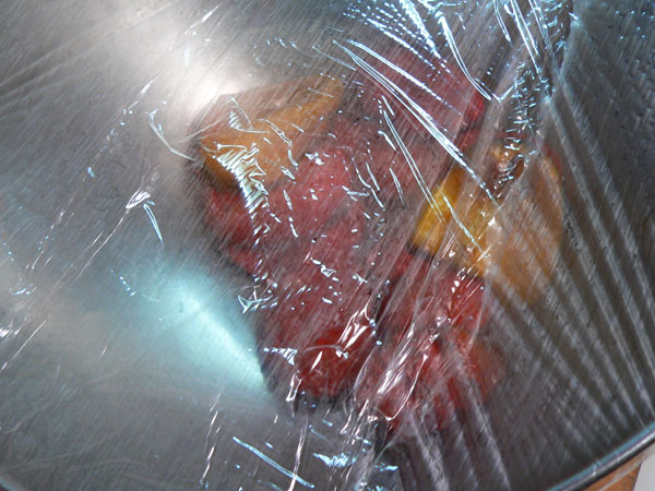 Roasted Peppers, cover with plastic wrap.