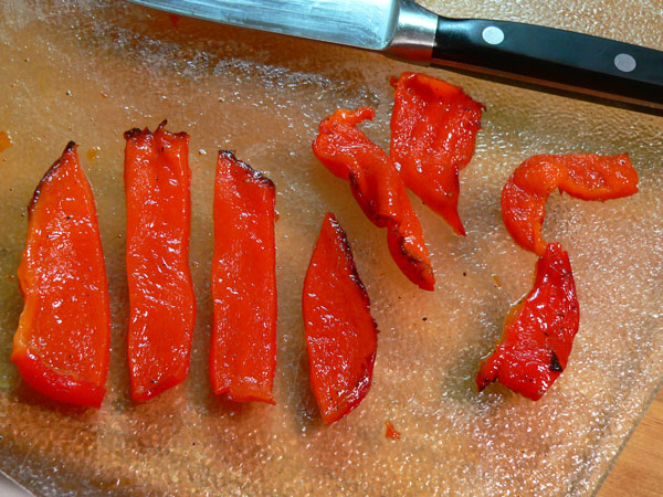 Roasted Peppers, slice the peppers.
