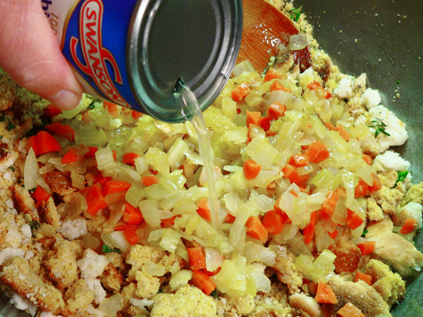 Cornbread Dressing, add the chicken broth.