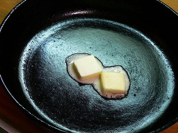 Cornbread and Eggs, melt some butter.