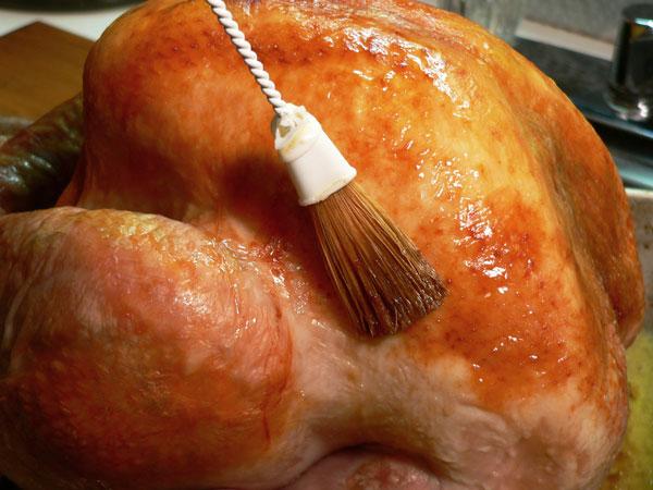 Roast Turkey, baste with pan juices.