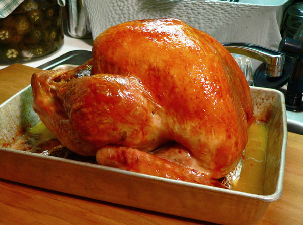 Roast Turkey, remove from oven.
